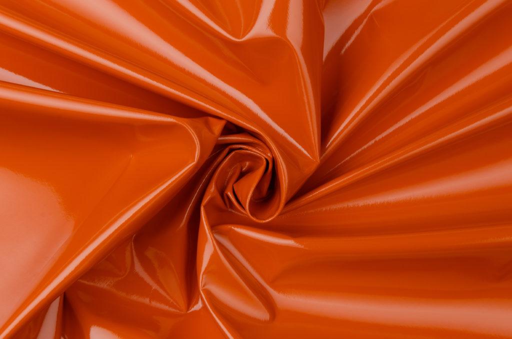 Fotografía de tela de charol naranja